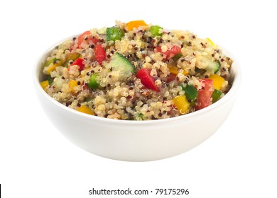 Delicious vegetarian quinoa salad with bell pepper, cucumber and tomatoes isolated on white (Selective Focus, Focus one third into the bowl)