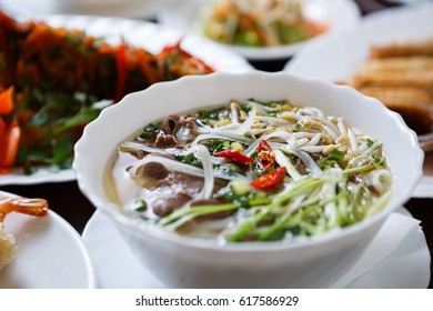 Delicious Vietnamese tradition restaurant food pho bo soup.Natural exotic food menu.Tasty Asian beef meat &noodles served in bowl.Popular soup from Asia.Enjoy tasty spicy vietnamese dish