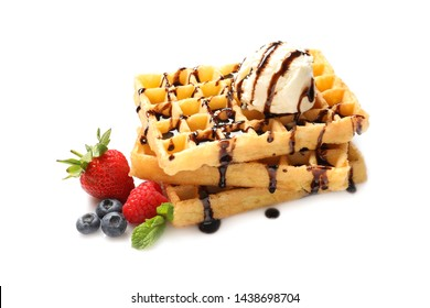 Delicious waffles with berries, ice cream and chocolate syrup on white background