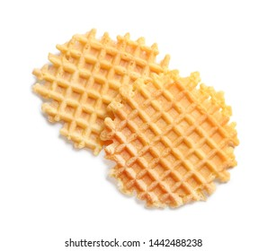 Delicious waffles for breakfast on white background, top view