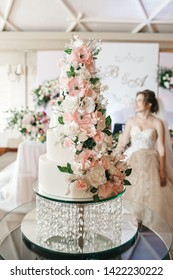 A delicious wedding cake is decorated with flowers