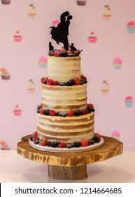Delicious wedding cake with fresh strawberries, berries, and rasberries.