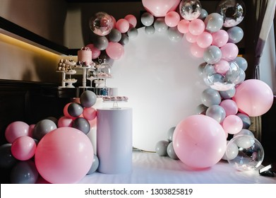Delicious wedding reception. Birthday Cake on a background balloons party decor. Copy space. Celebration concept. Trendy Cake. Candy bar. Table with sweets, candies, dessert.