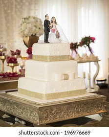 Delicious and well decorated wedding cake sitting in a reception.