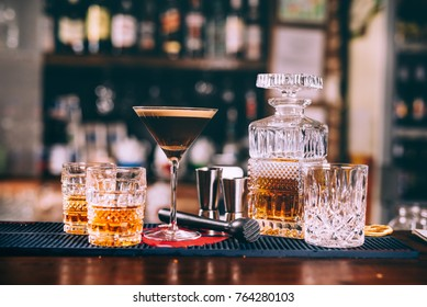 delicious whiskey based cocktails, alcoholic beverages in modern bar