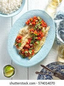 Delicious white fish veracruz with olives, capers, tomato, jalapeno pepper and cilantro.