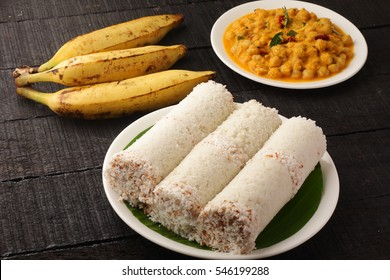 Delicious white rice puttu served with curry and fruits