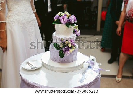 Delicious white wedding cake purple flowers stock photo edit now delicious white wedding cake with purple flowers at reception mightylinksfo
