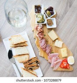 Delicious white wine cheese and charcuterie plate hors d'oeuvres at upscale wine bar
