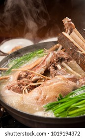Delicious whole duck soup in a hot pot