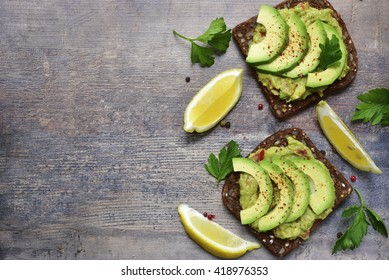 Delicious wholewheat toast with guacamole and avocado slices.Mexican cuisine.