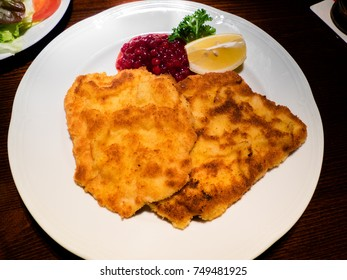 Delicious wiener schnitzel, traditional meat dish of Austria and Germany