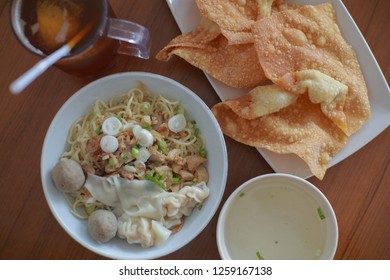 Delicious Yamie/Yammie - Indonesian Chicken Noodle with Soup served with Fried Crispy Dumpling and meatball
