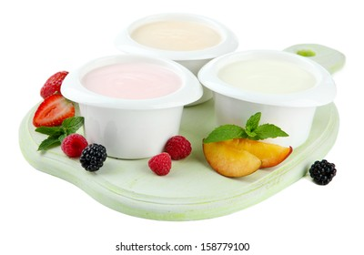 Delicious yogurt with fruit and  berries isolated on white