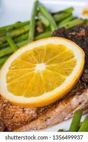 delicious zesty orange salmon with stir fried garlic asparagus