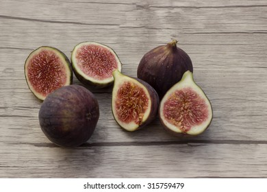 deliciously fresh figs on wooden background
