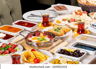 Delicious,Natural,Traditional Turkish Breakfast on the wooden table with copper egg pan.Top and large view.