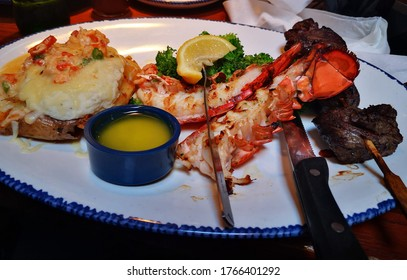 Deliciuos dinner, including lobster and meat.