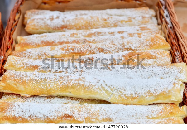 Deliciuos sweet puff pastry covered with sugar powder.