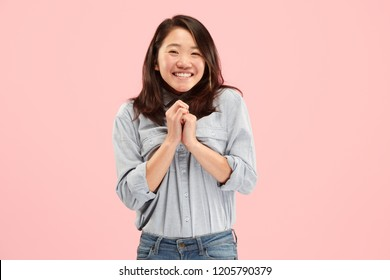 Delight. Beautiful female half-length front portrait isolated on pink studio backgroud. Young, emotional, smiling, surprised woman standing. Human emotions, facial expression concept. Trendy colors