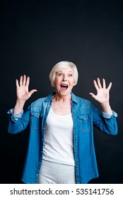 Delighted elderly woman expressing joy
