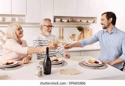Delighted family having dinner at home
