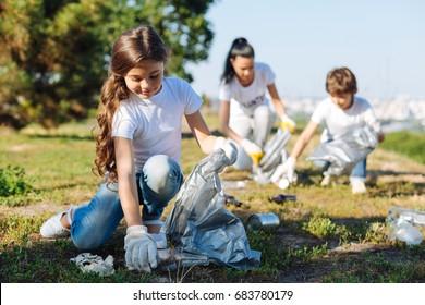 Delighted girl working in volunteer group