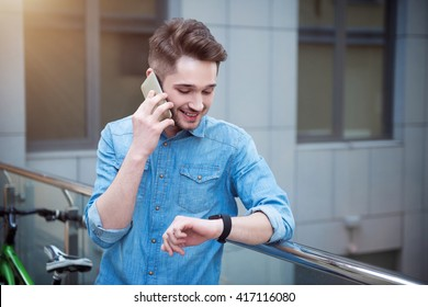 Delighted guy talking on cell phone