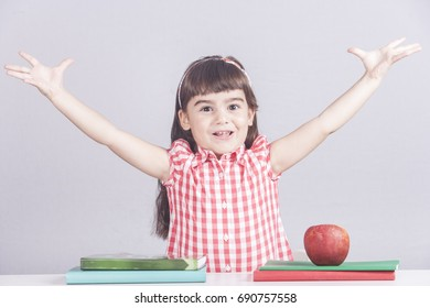 Delighted little schoolgirl. Education concept