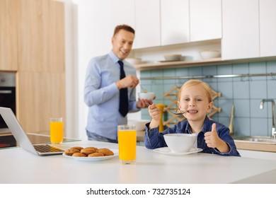 Delighted nice girl enjoying her food