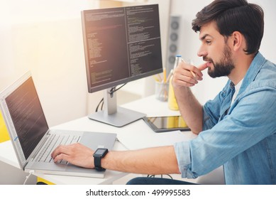 Delighted programmer working on a laptop