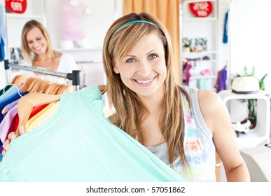 Delighted woman selecting item in a clothes shop