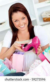 Delighted woman with shopping bags  at home
