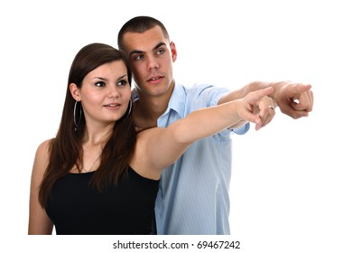 Delighted young couple pointing their index fingers to side isolated on white