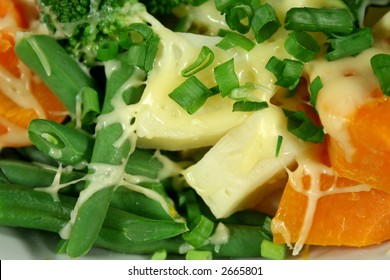 Delightful freshly steamed vegetables with melted cheese.