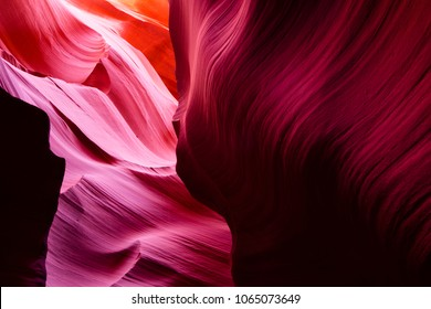 Delightful game of light and color on the gorgeous twisted colorful sandstone waves of the Lower Antelope Canyon in Page city Arizona enthralls everyone going into this slot canyon.