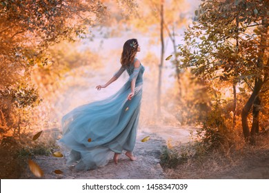 delightful light girl in sky blue turquoise dress with long flying train, princess of wind and daughter of storm, lady with dark hair throws fallen leaves to ground, autumn story in art processing