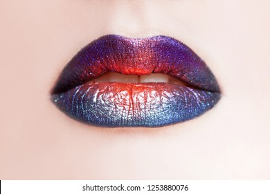 Delightful lip makeup, multi-colored transitions. Beautiful women's lips with bright lipstick, bright stylish makeup, close-up