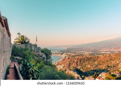 Delightful morning scenery on the town Taormina and the volcano Etna. View from Church of Madonna della Rocca in Taormina, Sicily, Italy