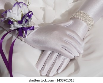 A delightful photo of a debutant's hands wearing beautiful gloves on the night of her ball.