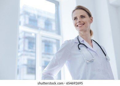 Delightful practitioner working in the clinic
