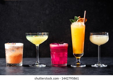 Delightful variously colored refreshment cocktail drinks aligned in order