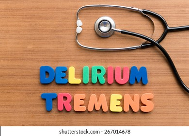 DELIRIUM TREMENS colorful word on the wooden background
