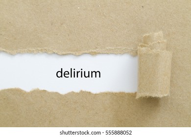Delirium word written under torn paper.