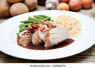 deliscious hot filet and greend beans on plate serving on wooden table
