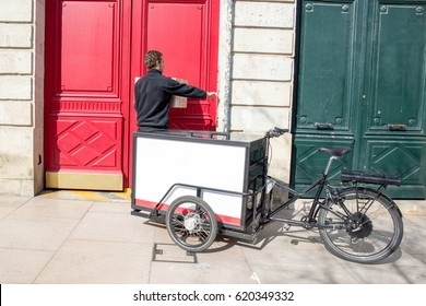 Delivered of packages by cycling courier tricycle cargo designed and constructed specifically for transporting loads