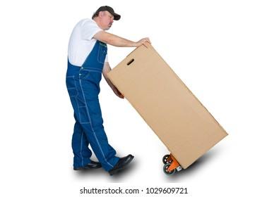 Deliverer transporting large cardboard box using trolley against white background