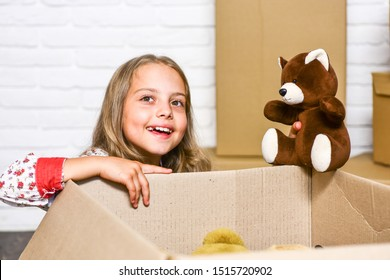 Delivering happiness. Little child open post package with toys. Deliver your treasures. Storage for toys. Delivering happy moments to childhood. Insurance post package. Relocating delivery services.