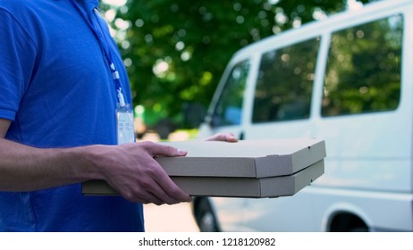 Delivery boy bringing hot tasty pizza, express food delivery, part-time job