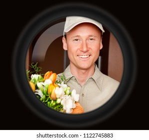Delivery Boy With Flowers Seen Through Door Viewer